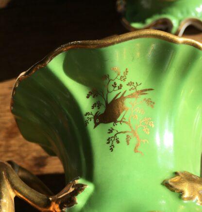 Garniture of Daniels vases, rococo with scenes, green ground, c.1830-17011