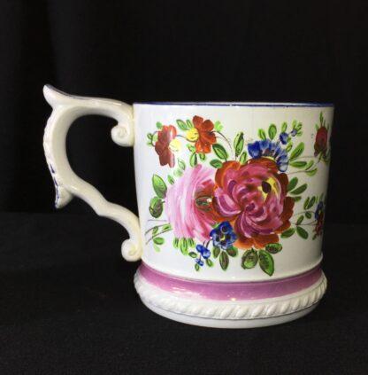 Pearlware mug, ornate handle with flower painting, inscribed AH 1831 -17269