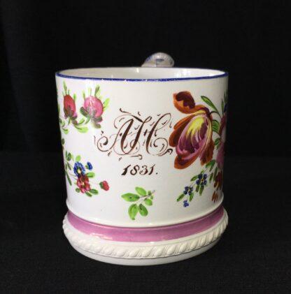Pearlware mug, ornate handle with flower painting, inscribed AH 1831 -17272
