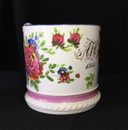 Pearlware mug, ornate handle with flower painting, inscribed AH 1831 -17274