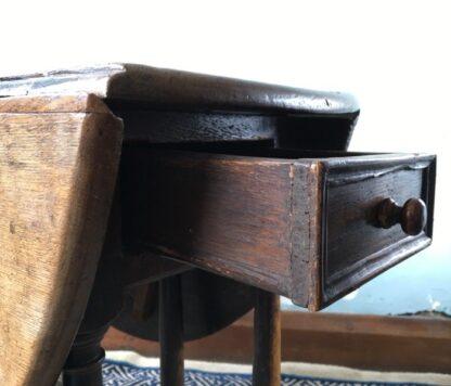 Oak gateleg table, single drawer, early 18th century. -24825