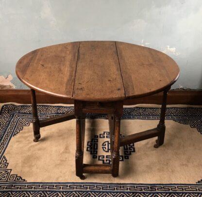 Oak gateleg table, single drawer, early 18th century. -24829
