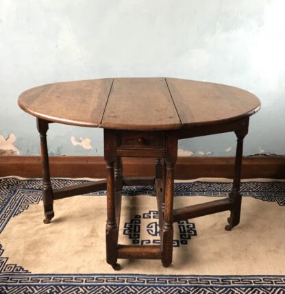 Oak gateleg table, single drawer, early 18th century. -0
