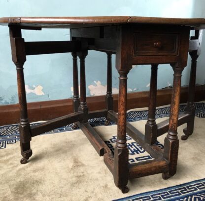 Oak gateleg table, single drawer, early 18th century. -24833