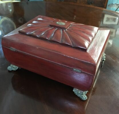 English red lacquer sarcophagus shaped sewing box with with ormolu mounts, draw and fitted interior , c. 1820-18344