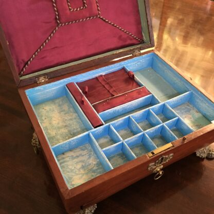 English red lacquer sarcophagus shaped sewing box with with ormolu mounts, draw and fitted interior , c. 1820-18346
