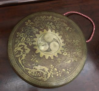 Oriental brass dinner gong decorated with birds and foliage, 19th Century -0