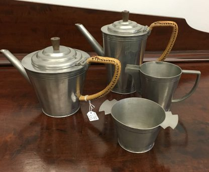 "Art Deco Malaysian pewter tea & coffee service, wicker handles, marked ""Malayan C.K.T Pewter"" c. 1920-0"