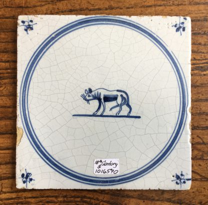 Dutch Delft glazed tile, dog, 17th century. -0