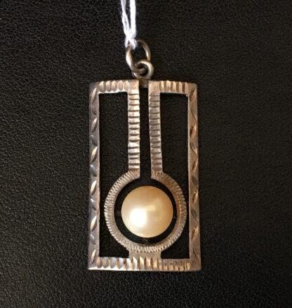 Art Deco silver openwork pendant with pearl, circa 1915-21028