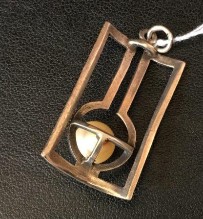 Art Deco silver openwork pendant with pearl, circa 1915-21029