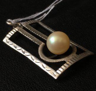 Art Deco silver openwork pendant with pearl, circa 1915-0