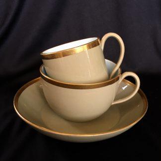 Wedgwood drabware trio, gilt rims, circa 1820-0