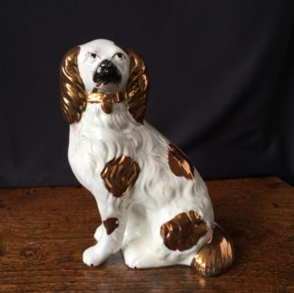Staffordshire pottery dog of medium size, with copper lustre spots, c. 1870-0