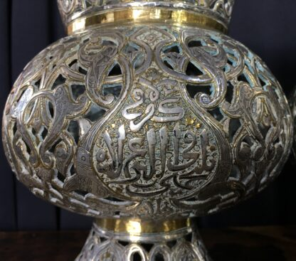 Large pair of Islamic brass vases or lanterns, pierced & inlaid with silver inscriptions, 19th c.-22600