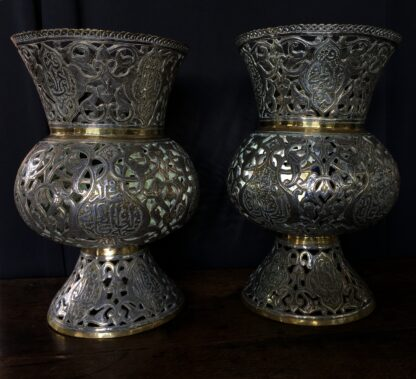 Large pair of Islamic brass vases or lanterns, pierced & inlaid with silver inscriptions, 19th c.-22602