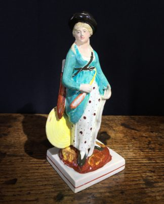 Early Staffordshire 'archery' lady figure, C. 1815-0