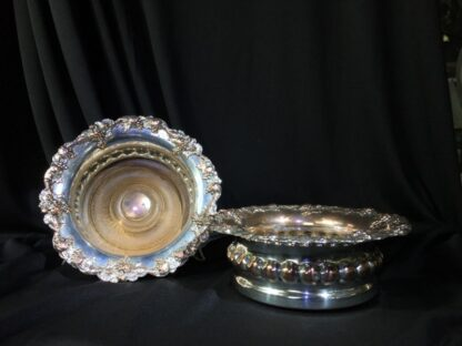 Old Sheffield Plate pair of Wine Coasters with fruiting vine rims, c. 1825-0