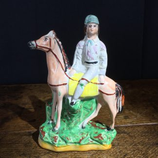 Unusual Staffordshire jockey on horse, possibly Fred Archer, c. 1890-0