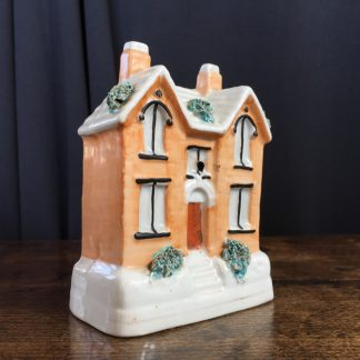 Staffordshire pottery cottage money box, 19th century.-0