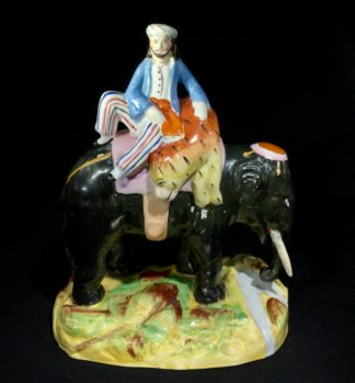 Staffordshire figure of elephant & rider with tiger, c. 1870-0