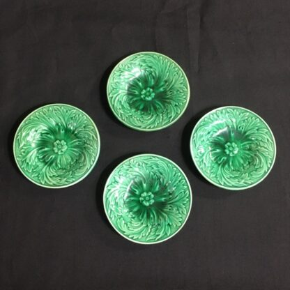Set of four small majolica plates C. 1870-0
