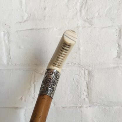 Malacca cane ridding crop with ivory grip & silver mount, 19th century -26711