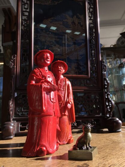 Pair of Chinese figures in coral red glaze, Qing Dynasty 19th century-28280
