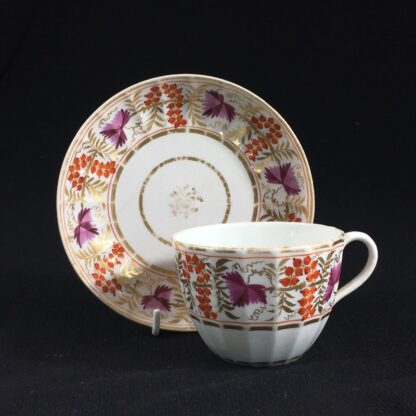 Coalport fluted cup & saucer, fruiting vine in red & purple, c. 1800-0