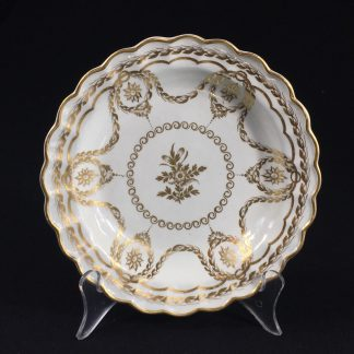 Caughley plate with rich Neo-classical gilding, circa 1780-0