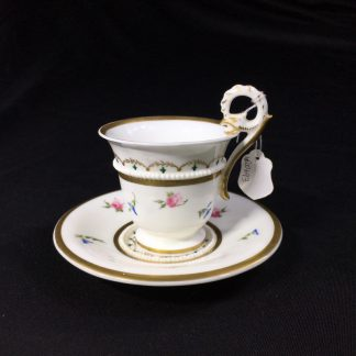 Nantgarw cup and saucer, serpent handle & flower sprigs, c. 1818-0