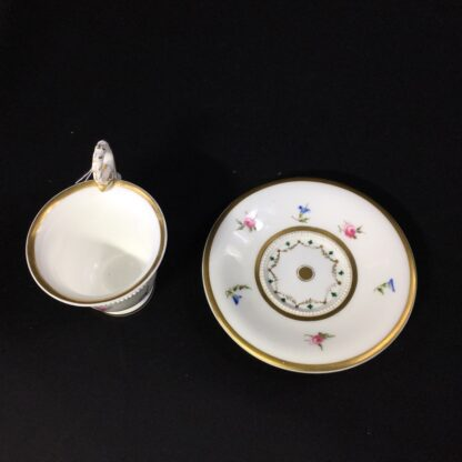 Nantgarw cup and saucer, serpent handle & flower sprigs, c. 1818-27268