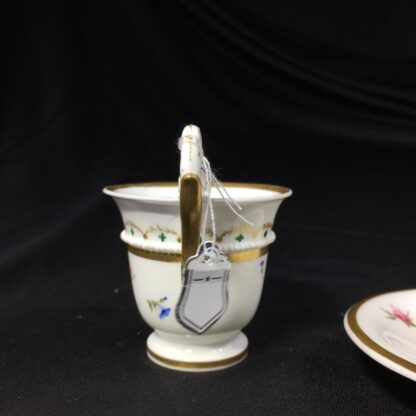 Nantgarw cup and saucer, serpent handle & flower sprigs, c. 1818-27266