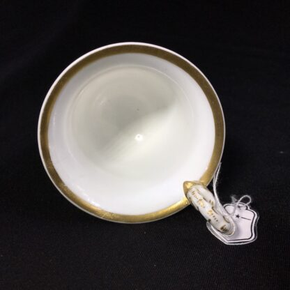 Nantgarw cup and saucer, serpent handle & flower sprigs, c. 1818-27270