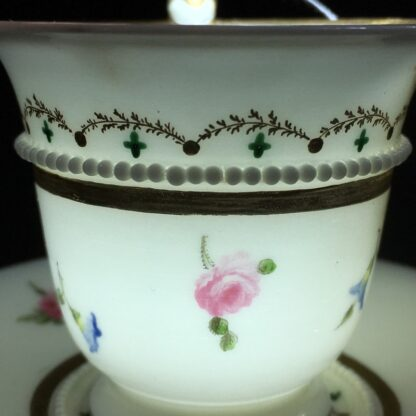 Nantgarw cup and saucer, serpent handle & flower sprigs, c. 1818-27278