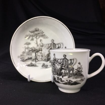 Worcester cup & saucer, Hancock 'Tea Party' print in black, c. 1770 -0