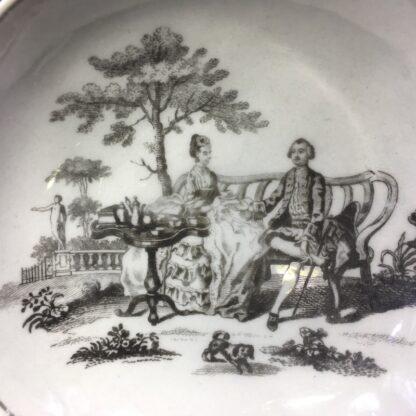 Worcester cup & saucer, Hancock 'Tea Party' print in black, c. 1770 -27681