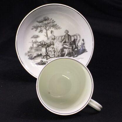 Worcester cup & saucer, Hancock 'Tea Party' print in black, c. 1770 -27690