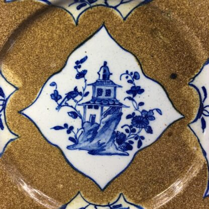 English delft plate, pagoda & flowers on brown ground, c. 1760 -28147