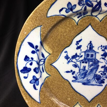 English delft plate, pagoda & flowers on brown ground, c. 1760 -28145