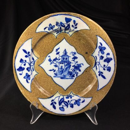 English delft plate, pagoda & flowers on brown ground, c. 1760 -0