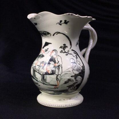English creamware jug, Dutch decorated with 'Jesuit' religious scene in black, c.1775 -0