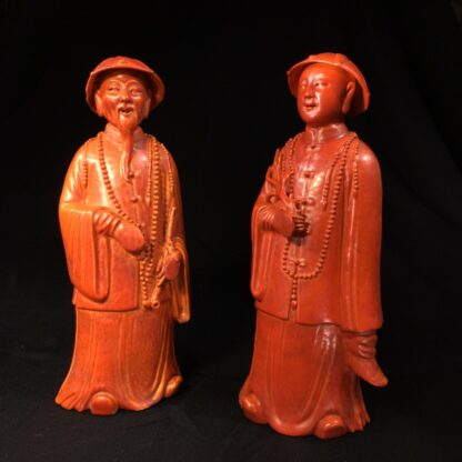 Pair of Chinese figures in coral red glaze, Qing Dynasty 19th century-0