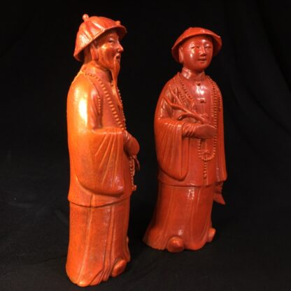 Pair of Chinese figures in coral red glaze, Qing Dynasty 19th century-28451