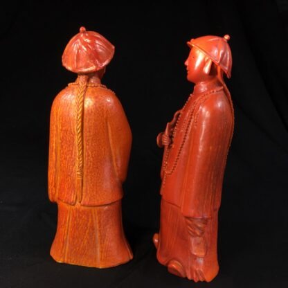 Pair of Chinese figures in coral red glaze, Qing Dynasty 19th century-28449