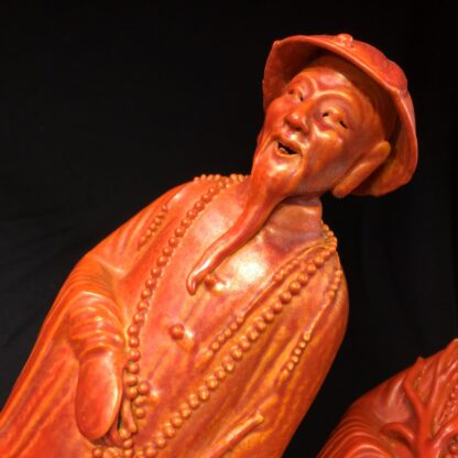 Pair of Chinese figures in coral red glaze, Qing Dynasty 19th century-28456
