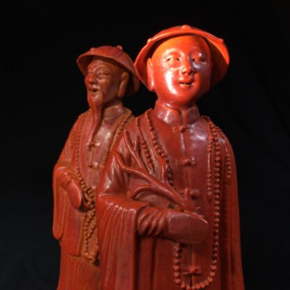 Pair of Chinese figures in coral red glaze, Qing Dynasty 19th century-28454