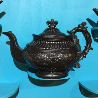 Cyples large black basalt teapot, flower moulding with ornate handle, c. 1825-0