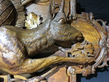 Pair of Swiss 'Black Forest' carved panels, chamois deer & hunting trophies, c.1880 -29057