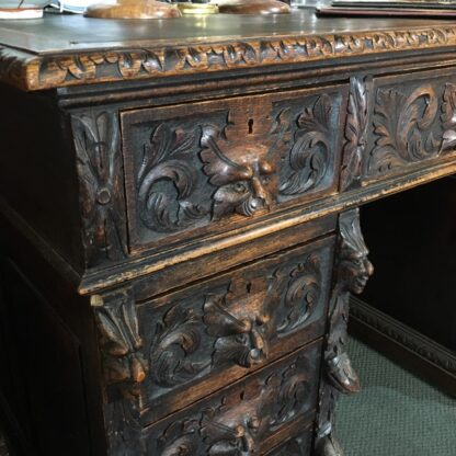 English oak desk with heavy 'Elizabethan' carving, c. 1870 -0